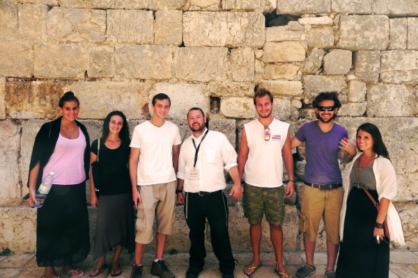 Jerusalem Heritage House Guests and Rabbi Ben Packer, Director of the Heritage House in front of the Kotel Katan - the Small Western Wall
