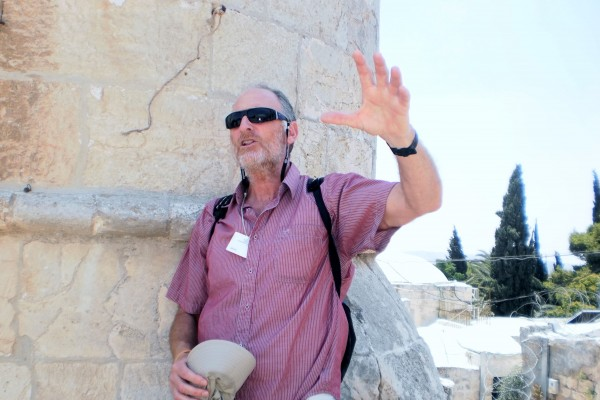 Tour Guide Explains to Guest of the Jerusalem Heritage house about the Jewish Significance of Mt. Zion.