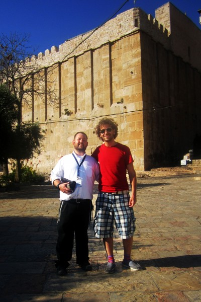 Red Junger a guest of the Heritage House and Rabbi Ben Packer in front of the cave of the patriarchs
