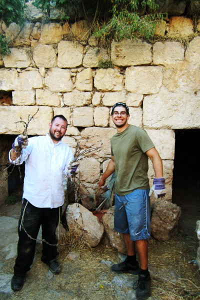 Rabbi Ben Packer Director of the Jerusalem Heritage House and Zach Kerner a guest of the Jerusalem Heritage House clean out the Ancient Synagogue of debris
