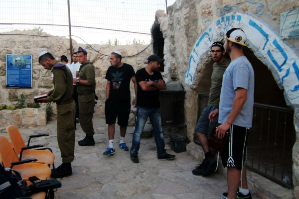 Praying Mincha at the Kever of Ruth and Yishai, with guests from the Jerusalem Heritage House. Our guests receive free accommodations, tours, and educational classes to connect them to Israel and the Jewish people.