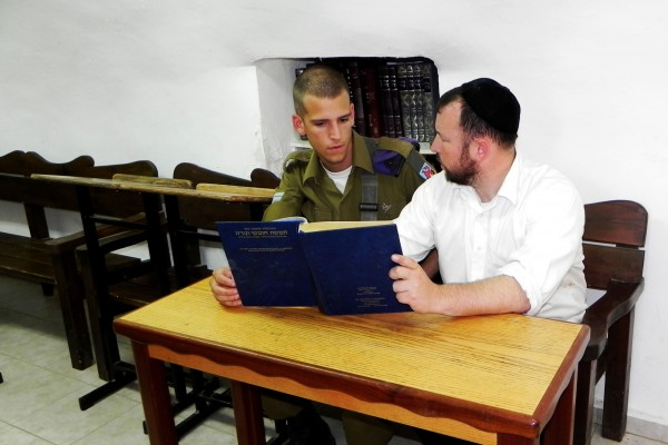 Rabbi Ben Packer Director of Heritage House, and Jonathan Helfer a Heritage House Lone Soldier, Learning from the newly donated Art Scroll Chumash.