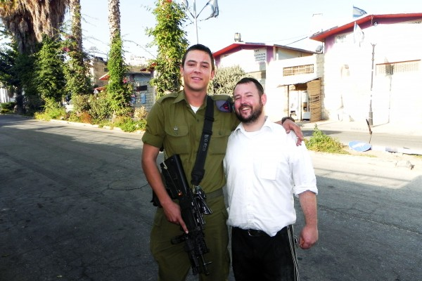 Rabbi Ben Packer, Director of Jerusalem Heritage House With one of Jerusalem Heritage House's 'lone soldiers' Glenn Heilbronn on the streets in Hevron! — ‎at ‎Hevron - חברון‎.‎