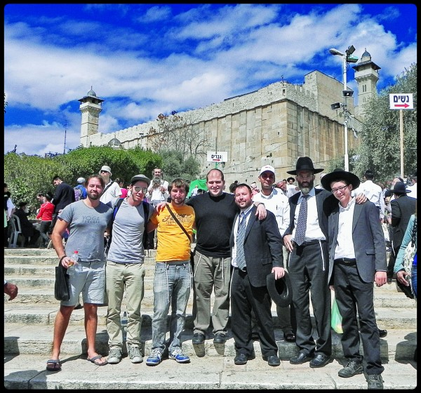 Rabbi Ben Packer Director of Heritage House and Heritage House Guests and friends of the Heritage House, Take a tour of Hebron starting with a picture in front of the Tomb of the Patriarchs.