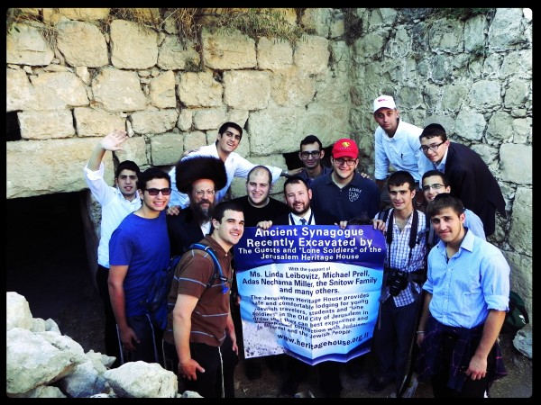 Rabbi Ben Packer, Director of the Jerusalem Heritage House, and Guests of the Heritage House puts up a sign for the recently excavated synagogue in Hebron. excavated by Heritage House Guests over the last year.