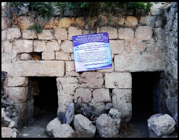the Synagogue excavated by the Jerusalem Heritage House with the sign.