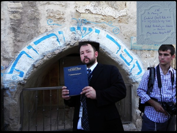 Rabbi Ben Packer, Jerusalem Heritage House Director, Donating an Artscroll Chumash from Asher David Milstein in memory of the soldier, Gal Kobi hy'd, who was recently killed in the area, to the active synagogue next to the tombs of Yishai and Ruth.