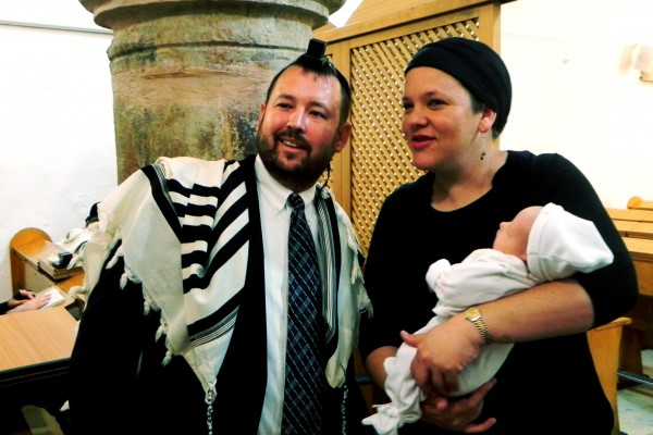 Rabbi Ben Packer, Director of the Heritage House, and Esther Packer Wife of Rabbi Ben Packer, and son Aryeh Packer, after the bris.