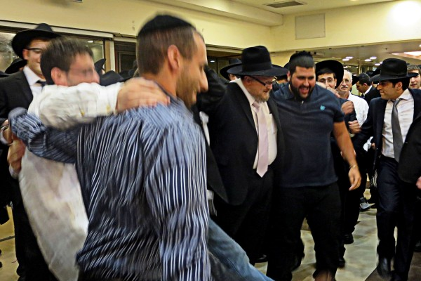 Heritage House Guests do the mitzva of making the groom happy! by dancing for him.