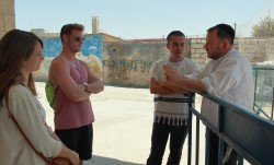 Rabbi Ben Packer Giving a tour to Birthright extenders, guests, and Lone Soldiers