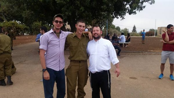 "Director Rabbi Ben Packer with ""lone soldiers"""