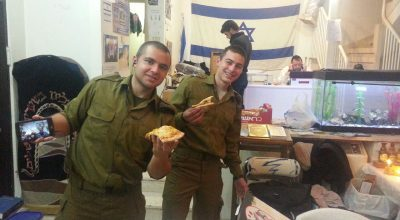 """Our """"lone soldiers"""" and guests celebrating Hanukkah"""