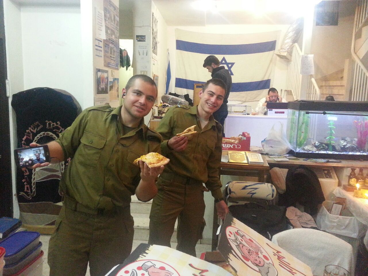 Our ``lone soldiers`` and guests celebrating Hanukkah