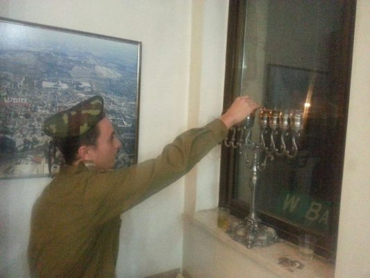 "Our ""lone soldiers"" and guests celebrating Hanukkah"